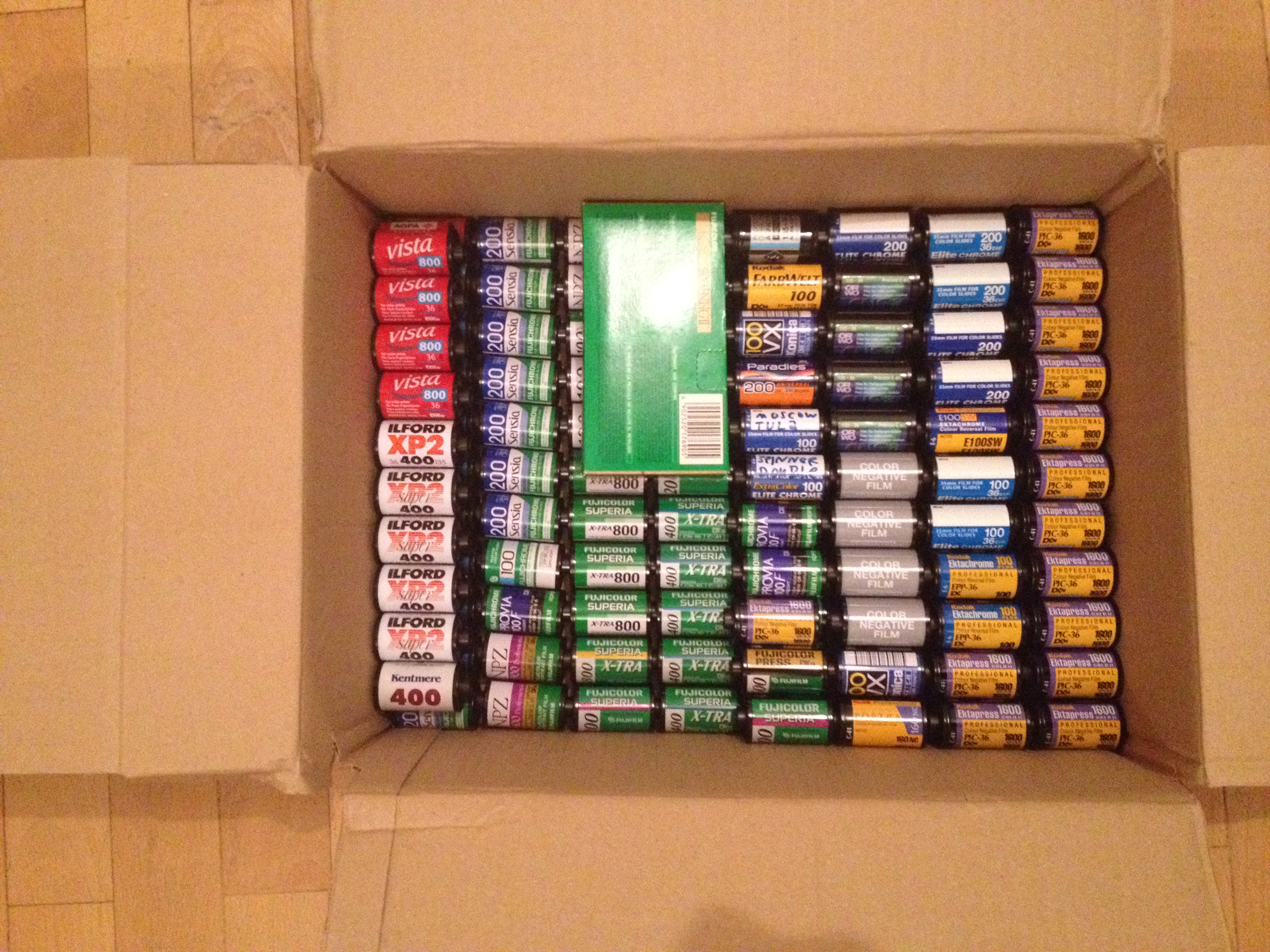 Box full of exposed film ready for development